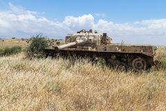 Destroyed Israeli tank is after the Doomsday Yom Kippur War on the Golan Heights in Israel,  near the border with Syria. Destroyed Israeli tank is after the Stock Images