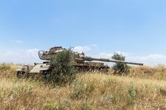 Destroyed Israeli tank is after the Doomsday Yom Kippur War on the Golan Heights in Israel,  near the border with Syria. Destroyed Israeli tank is after the Stock Photo