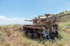 Destroyed Israeli tank is after the Doomsday Yom Kippur War on the Golan Heights in Israel,  near the border with Syria. Destroyed Israeli tank is after the Royalty Free Stock Photos