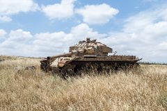 Destroyed Israeli tank is after the Doomsday Yom Kippur War on the Golan Heights in Israel,  near the border with Syria. Destroyed Israeli tank is after the Royalty Free Stock Images