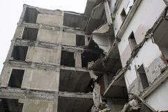 Destroyed large building with no external walls in the aftermath of the explosion. Background royalty free stock image