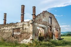 Free Destroyed Old Brick House Without Roof And With Chimneys, Broken Windows, Window Frames, Door And Bricks Royalty Free Stock Photography - 118415257