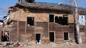 Destroyed old house in the province of Russia, poverty.  stock video footage