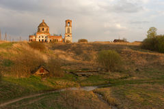 Destroyed Orthodox Church. Destroyed Orthodox Church in the field. Evening Stock Image