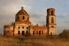 Destroyed Orthodox Church. In the field. Evening Stock Photography