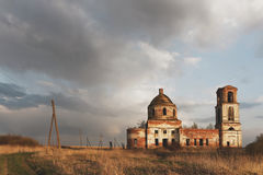 Destroyed Orthodox Church. Destroyed Orthodox Church in the field. Evening Stock Images