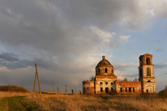 Destroyed Orthodox Church. Destroyed Orthodox Church in the field. Evening Royalty Free Stock Photos