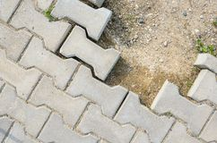 Destroyed Paving of the Sidewalk. The destroyed Laying of Paving Slabs Royalty Free Stock Photo