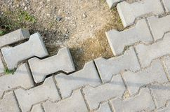 Destroyed Paving of the Sidewalk. The destroyed Laying of Paving Slabs Stock Image