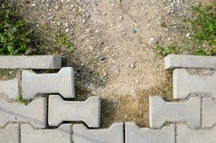 Destroyed Paving of the Sidewalk. The destroyed Laying of Paving Slabs Stock Photography