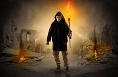 Man coming with burning flambeau at a catastrophe scene concept Royalty Free Stock Photography