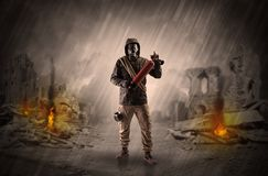 After catastrophe men coming in gas mask and arms. Destroyed place after a catastrophe with man in gas mask and weapon on his handn stock photos
