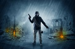 After catastrophe men coming in gas mask and arms. Destroyed place after a catastrophe with man in gas mask and weapon on his handn stock photography