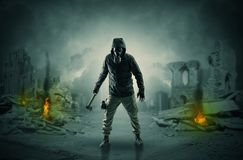 After catastrophe men coming in gas mask and arms. Destroyed place after a catastrophe with man in gas mask and weapon on his handn royalty free stock photo