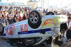 Destroyed police car. ISTANBUL - JUN 1: Violence sparked by plans to build on the Gezi Park have broadened into nationwide anti government unrest on June 1, 2013 Royalty Free Stock Photos