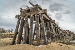 Destroyed railroad timber trestle Stock Photo