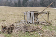 Destroyed raised hide on a meadow in the winter. The picture was made at a cold winter day Royalty Free Stock Photo