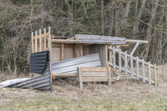 Destroyed raised hide on a meadow in the winter. The picture was made at a cold winter day Royalty Free Stock Photography