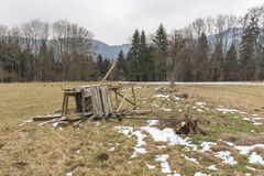 Destroyed raised hide on a meadow in the winter. The picture was made at a cold winter day Royalty Free Stock Photos