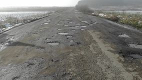 Destroyed road, difficult traffic area, threat of traffic accident. Countryside, Ukraine stock video