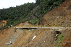 Destroyed road landslide damaged of powerful flood in the mountains of Colombia Royalty Free Stock Photo