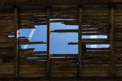 Destroyed roof - ruined , demolished construction - aged wooden roof / wall Royalty Free Stock Photography