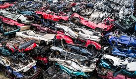 Destroyed scrapped cars stacked on a scrap yard. Royalty Free Stock Images