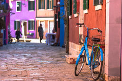 Destroyed sometimes bicycle leaning colored house in Burano, Ita Royalty Free Stock Photography