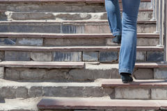 Destroyed steps. Woman rises up on the destroyed steps stock image