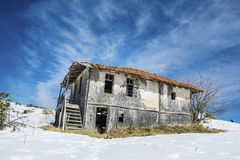 Destroyed straw  house in the winter Royalty Free Stock Images
