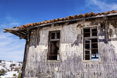 Destroyed straw  house in the winter Stock Photos