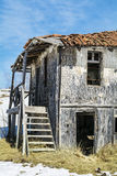 Destroyed straw  house in the winter.close up Royalty Free Stock Images