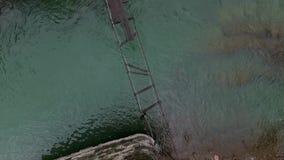 Destroyed suspension bridge over river in Carpathians. Top view stock video