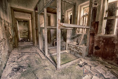 Destroyed toilet. In an abandoned room royalty free stock photo