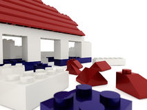 Destroyed toy house on white Stock Images