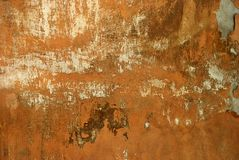 Destroyed Wall. Ancient destroyed cracked orange front facade royalty free stock photos