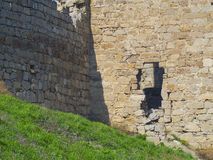 Destroyed wall of the old Genoese fortress Stock Image