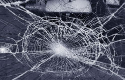 Destroyed window-pane. Photo of a destroyed window-pane stock photography