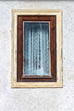 Destroyed window pane in a wood window. A Destroyed window pane in a wood window at the village Royalty Free Stock Photography