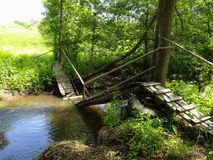 Destroyed wooden bridge over river in Russia. Royalty Free Stock Photo