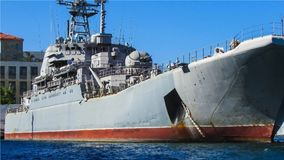 Destroyer, the navy. A gray warship in the port. Defense, siege, military exercises, maneuvers. On board modern equipment. Navy. Sunny day, blue sky and the sea Royalty Free Stock Photography