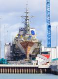 Destroyer under construction in a naval shipyard Stock Photos