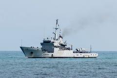 Destroyer war ship in action for migrants boat. Destroyer war ship in action in mediterranean sea Stock Images