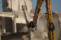 Destroying 018. Destroying of a house by a machine Stock Images