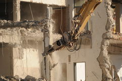 Destroying 021. Destroying of an old house by a machine Stock Photography