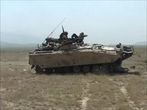 Destroying an Armoured vehicle with a CV90 Tank in Afghanistan. In 2012 stock video