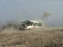 Destroying an Armoured vehicle with a missile. Destroying an Armoured vehicle with an anti tank missile in Afghanistan in 2012 stock footage