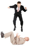 Destroying the competition. One businessman jumping on another businessman Royalty Free Stock Photo