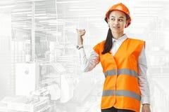 Destroying gender stereotypes. Female builder standing against industrial background. Destroying gender stereotypes. Female builder in male profession. Woman stock image