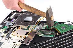 Destroying laptop with a hammer Royalty Free Stock Photography